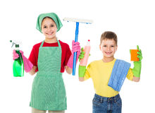 Crianças felizes com equipamento da limpeza Imagens de Stock