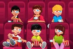 Crianças felizes que vão a um filme Fotografia de Stock
