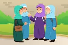 Crianças muçulmanas que falam junto Imagem de Stock