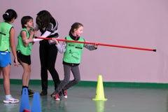 Crianças na competição do atletismo dos miúdos Fotografia de Stock
