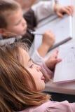 Crianças na escola Fotos de Stock