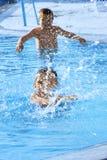 Crianças na piscina Imagens de Stock Royalty Free