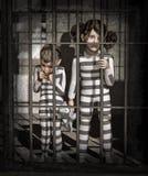 Crianças na prisão Imagem de Stock Royalty Free