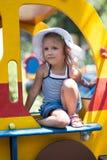 Crianças no campo de jogos Foto de Stock Royalty Free