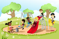 Crianças no campo de jogos Imagem de Stock Royalty Free
