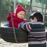 Crianças no campo de jogos Fotografia de Stock Royalty Free