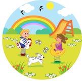 Crianças no campo de jogos no tamanho redondo Fotos de Stock