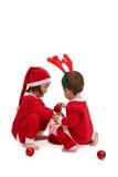 Crianças pequenas no jogo do traje de Santa Fotos de Stock