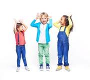 Crianças que amolam Fotografia de Stock