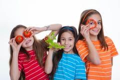 Crianças que comem o alimento saudável Fotografia de Stock