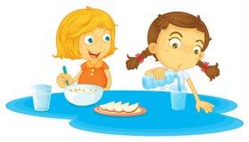 Crianças que comem o café da manhã ilustração royalty free