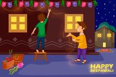 Crianças que decoram a casa para comemorar o festival de Diwali da Índia Fotografia de Stock