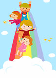 Crianças que deslizam em um arco-íris Foto de Stock Royalty Free