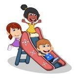 Crianças que jogam em uns desenhos animados da corrediça Imagens de Stock
