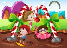 Crianças que jogam no rio do chocolate na terra Foto de Stock Royalty Free