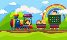 Crianças que montam no trem Foto de Stock Royalty Free