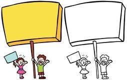 Crianças que prendem sinais Fotos de Stock Royalty Free