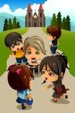 Crianças que vão à igreja Fotografia de Stock Royalty Free