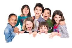 Crianças sobre a placa branca fotos de stock royalty free