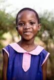 Crian?a na escola em Uganda imagens de stock