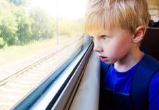 Crian?a no trem fotografia de stock royalty free