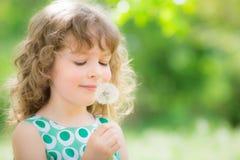 Criança bonita na mola Fotos de Stock Royalty Free