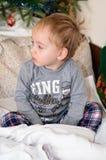 Criança bonito na cama Fotos de Stock Royalty Free
