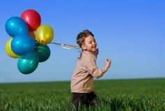 Criança com balões Imagens de Stock Royalty Free