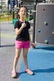Criança com o Lollipop no campo de jogos Fotografia de Stock Royalty Free