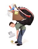 Criança com o saco de livro pesado dos trabalhos de casa da escola Fotografia de Stock Royalty Free