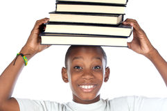 Criança com os livros na cabeça Imagens de Stock Royalty Free