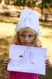 Criança com pintura da cara no chapéu Fotografia de Stock Royalty Free