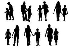 Criança com uma família Imagens de Stock