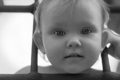 Criança da menina atrás das barras Fotografia de Stock Royalty Free