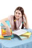 A criança da menina na tabela com livros Fotografia de Stock Royalty Free