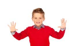 Criança de sorriso que mostra suas duas mãos abertas Imagens de Stock