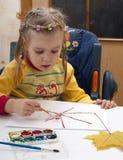 A criança desenha Foto de Stock