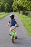 Criança do ciclismo Imagens de Stock Royalty Free