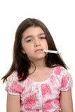 Criança doente com termômetro Imagens de Stock