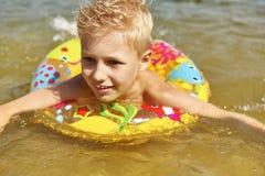 Criança feliz com anel de flutuação Imagens de Stock Royalty Free