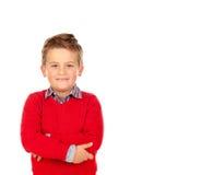 Criança loura bonito com jérsei vermelho Fotografia de Stock