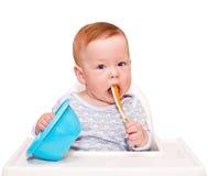 Criança na cadeira para alimentar Imagens de Stock Royalty Free