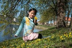 Criança na flor Fotos de Stock Royalty Free