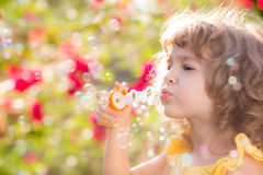 Criança na mola Fotos de Stock Royalty Free