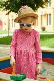 Criança no campo de jogos no parque do verão Fotos de Stock Royalty Free