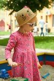A criança no campo de jogos no parque do verão Fotografia de Stock