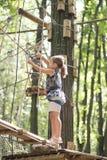 Criança no parque da aventura Imagem de Stock