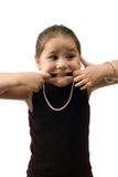 Criança que faz as faces Foto de Stock Royalty Free