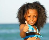 Criança que indica os polegares acima Imagem de Stock