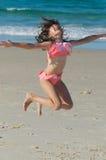 A criança que salta para a alegria Fotografia de Stock Royalty Free